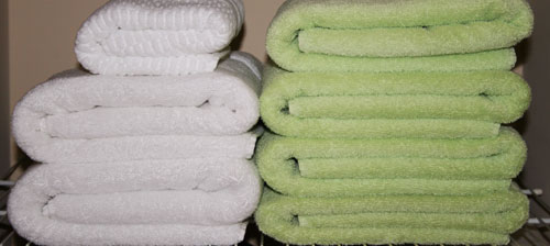 folded towels in linen closet