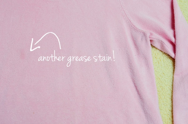 grease stain on pink sweater