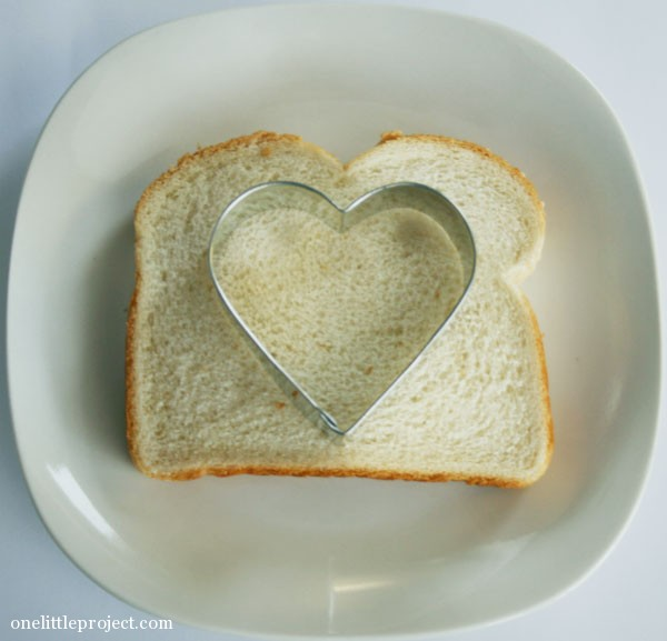 heart cookie cutter on bread