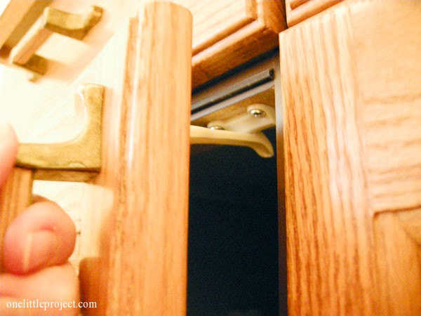 installing safety latches on cupboard