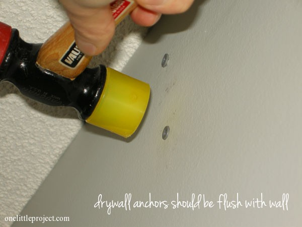 insert drywall anchors using a rubber mallet