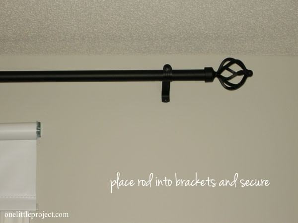 place rod into brackets and secure