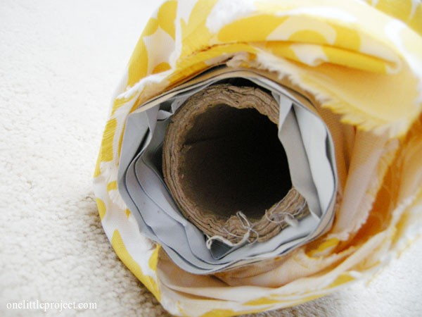 fabric and drapery lining on cardboard tube