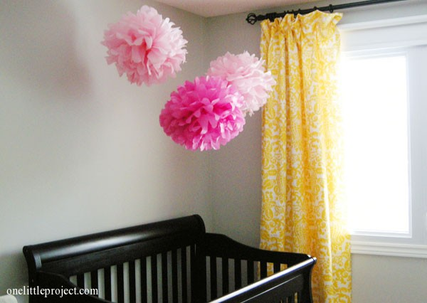 tissue paper poofs above crib