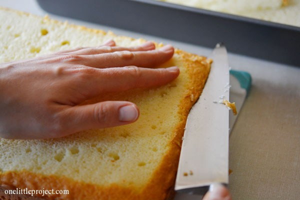 Slice off top layer of cake to make it flat