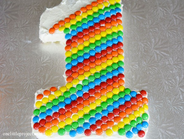 Rainbow M&M's first birthday cake   onelittleproject.com