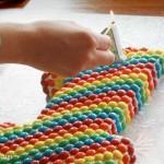 Rainbow M&M's first birthday cake