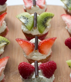 Decorate with fruit pieces to make mini butterfly muffins