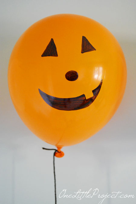 These permanent marker balloon pumpkins are super cheap and easy to put together.  And when you are done, there is nothing to store!