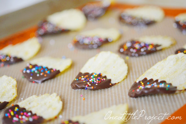 Chocolate dipped potato chips - Melt chocolate, dip, sprinkle and you are done!  Check out the full tutorial here.