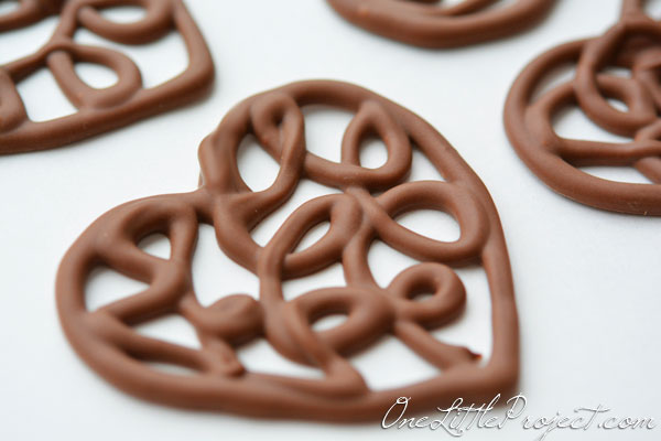 Here's an easy way to make chocolate filigree hearts. These would make the cutest cupcake toppers!