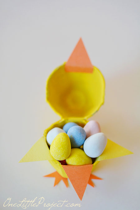 These fun little candy filled Easter egg carton chicks are a super cute Easter craft idea for kids.