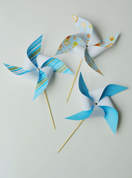 These paper pinwheels make beautiful party decorations!  They are easy to make, go together in minutes and are a fun addition to your summer decor!