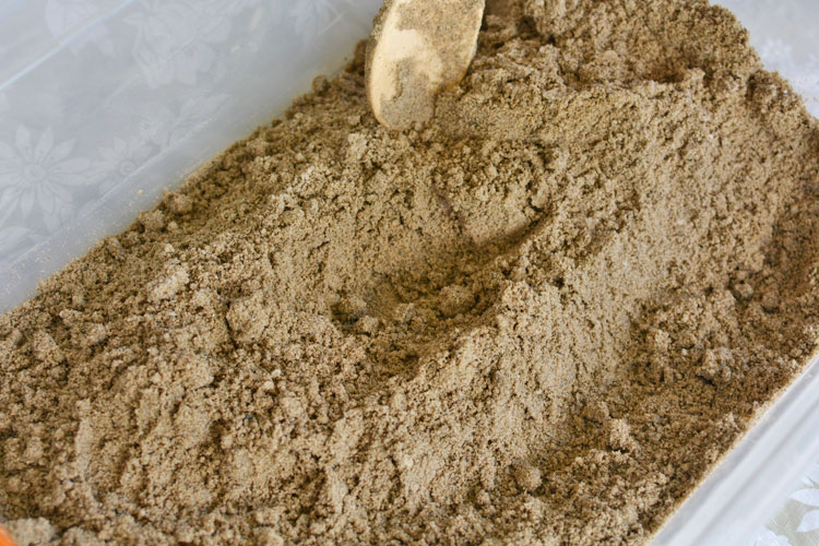 This moldable play sand recipe has just three ingredients! It has a great texture and it doesn't stick to your hands, so it's really easy to clean up!