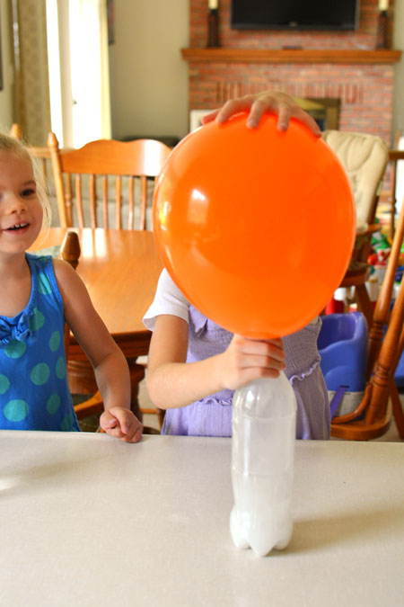 This was such a FUN science experiment! Mix together vinegar and baking soda and watch as the reaction inflates the balloon!