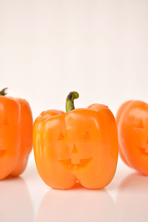These stuffed pepper jack-o-lanterns make a fabulously healthy Halloween meal idea! They are surprisingly simple to make, and they look absolutely adorable!