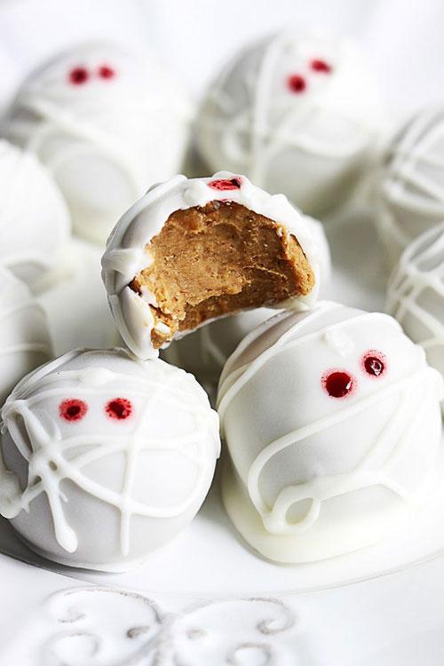 Halloween Party Ideas for Adults - Pumpkin Cheesecake Truffle Mummies (No-Bake)