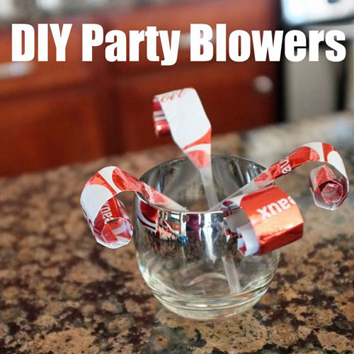 19 Christmas Wrapping Paper Crafts - DIY Party Blowers