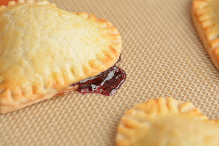 Pie crust cookies with jam oozing out