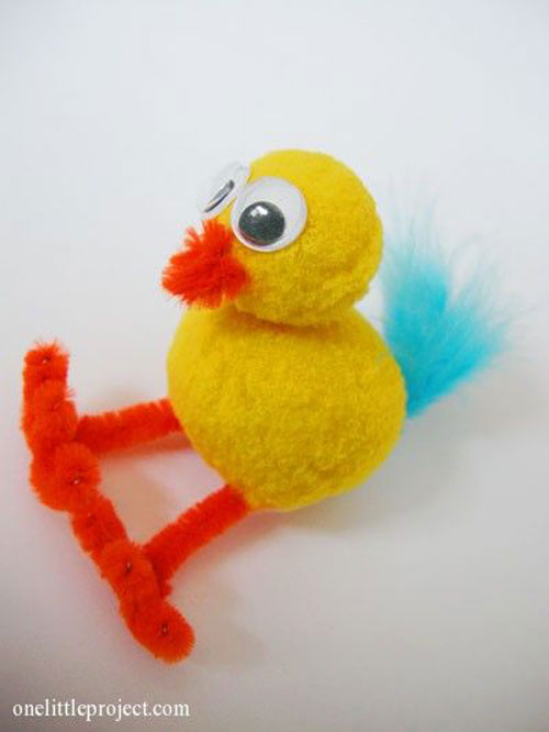 40 simple easter crafts for kids one little project 40 simple easter crafts for kids baby chick pom pom craft negle Image collections