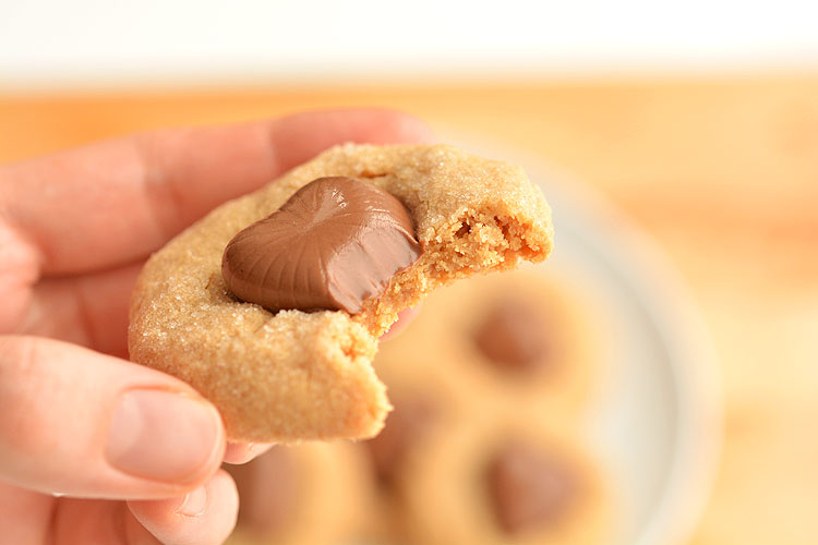 These chocolate heart peanut butter cookies are the EASIEST cookies ever! They only use 3 ingredients plus the chocolate hearts and they and taste amazing!!