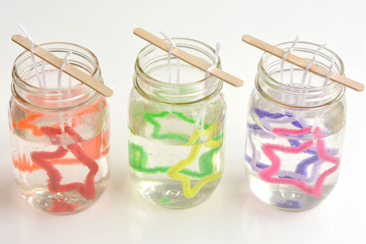 Pipe cleaner stars in mason jars with borax mixture