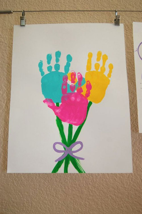 40+ Simple Easter Crafts for Kids - Hand Print Flower Easter Art