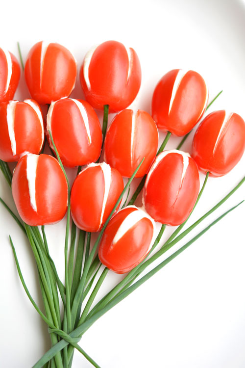 These cherry tomato tulips are SO PRETTY and they taste amazing! They'd be a great appetizer for a party or even Mother's Day! And the whipped feta filling is soooo good!