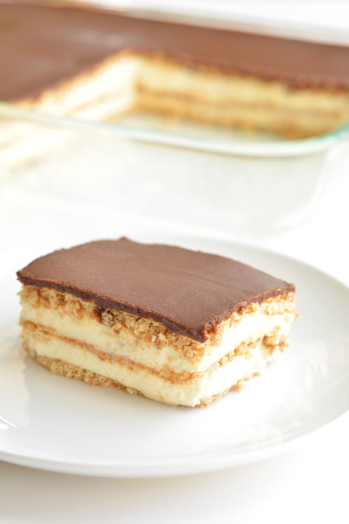 Slice of chocolate eclair cake on a white plate