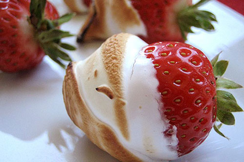 30+ Best Campfire Desserts - Roasted Strawberries in Marshmallow Fluff
