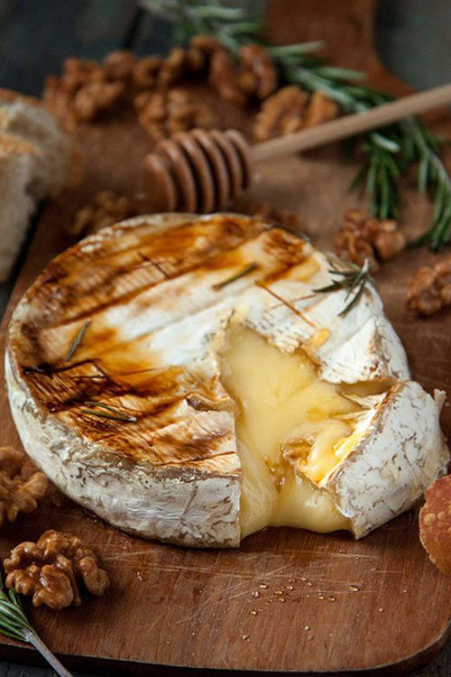 21 Things You Didn't Know You Could Grill - Baked Brie with Honey, Rosemary and Candied Walnuts