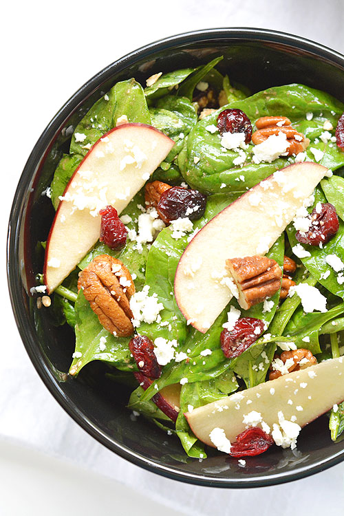 This apple cranberry pecan salad is SO GOOD and so easy! You can make it in less than 5 minutes! The sweet crunch of the apples pairs amazingly well with the feta and pecans. Yum!