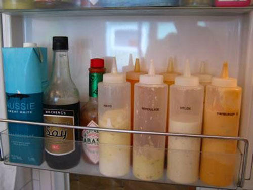 25 Hacks to Organize your Fridge - Fit more on the fridge door by using inexpensive squeeze bottles for all of your condiments