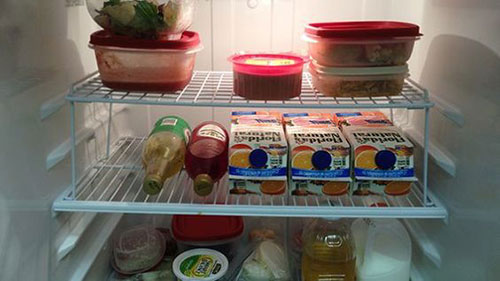 25 Hacks to Organize your Fridge - Use a cheap wire rack to add an extra shelf and double your storage space