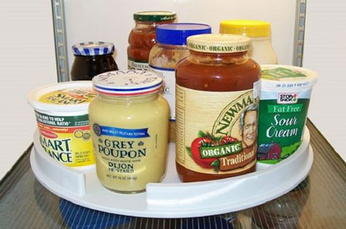 25 Hacks to Organize your Fridge - Use a lazy susan to make it easy to access all of your condiments