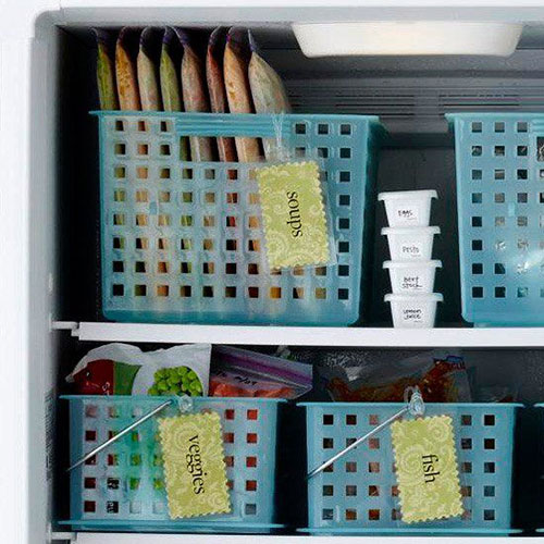 25 Hacks to Organize your Fridge - Use bins in the freezer to keep things organized