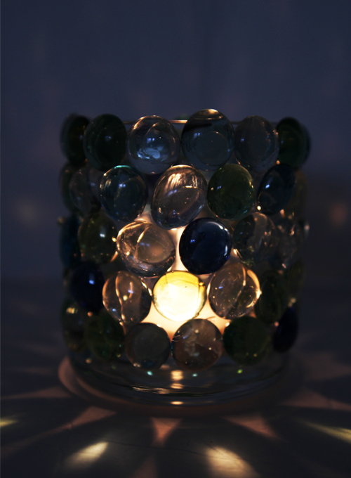 These glass bead candle holders are SO EASY to make and they look so pretty! Such a simple and beautiful dollar store craft project! Look at the beautiful shadows it makes!