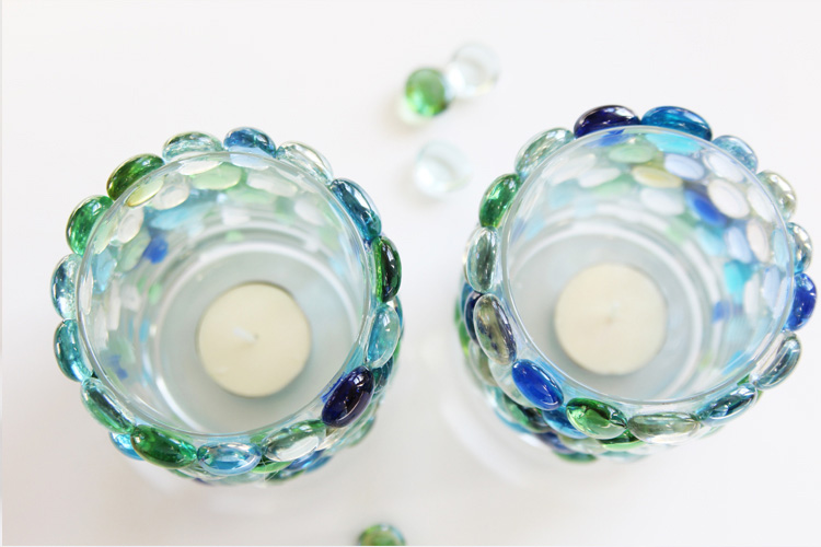 These glass bead candle holders are SO EASY to make! Grab your supplies at the dollar store for this super cheap yet pretty DIY!