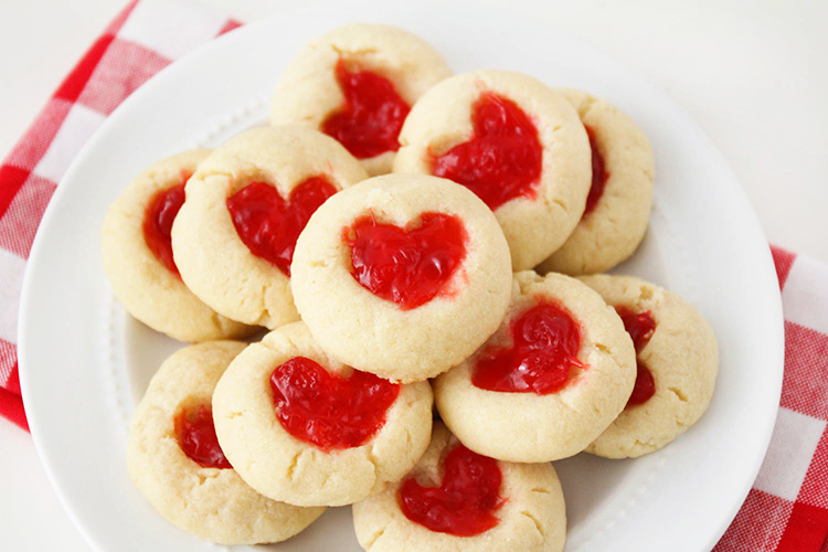 These rich and buttery gummy bear heart cookies have a sweet and chewy candy center and a simple shortbread base. They're so delicious and adorable too!