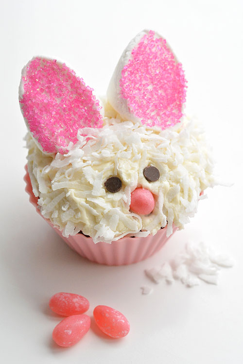 These Easter bunny cupcakes are SO ADORABLE! And they are so simple to make! Those marshmallow ears are just brilliant, and I love the coconut fur! Such a fun idea for an Easter treat, or even a spring birthday party!