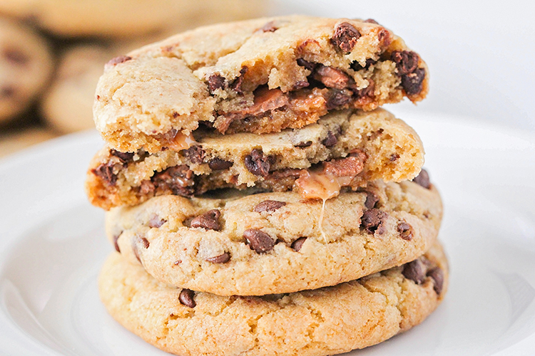 These caramel stuffed chocolate chip cookies are the perfect indulgent treat! They're so easy to make, and loaded with gooey caramel!