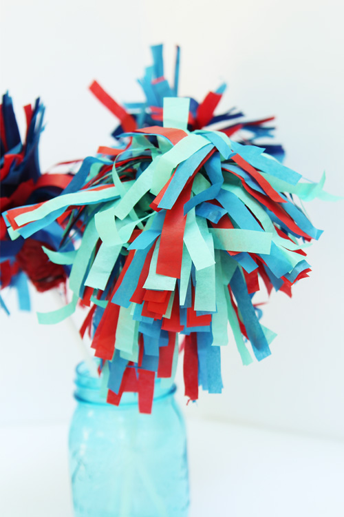 These tissue paper sparklers are SO FUN and and make the perfect summer centerpiece!