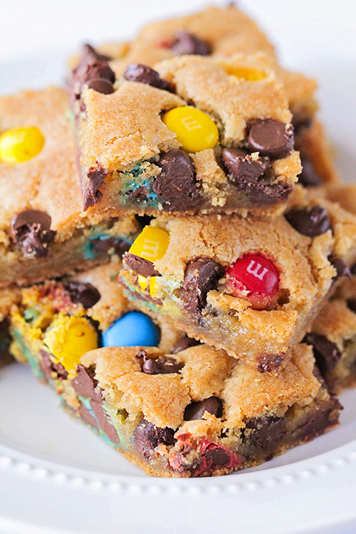 These M&M's cookie bars are crisp on the outside, and warm and gooey in the middle. They're loaded with chocolate chips and M&M candies, and so delicious!