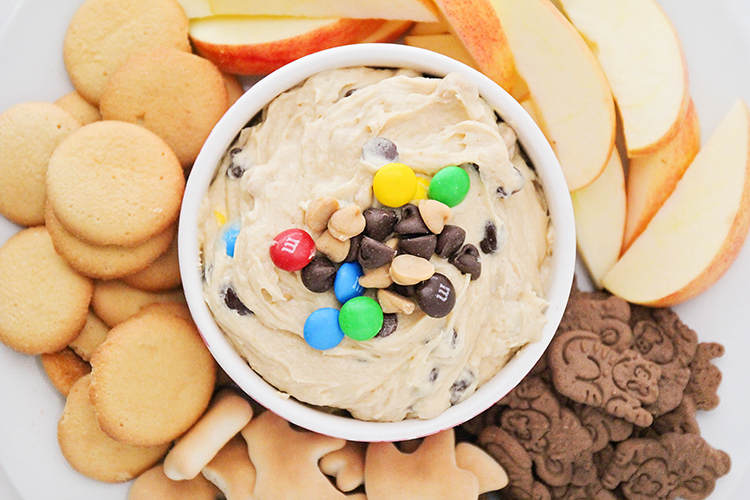 This sweet and delicious peanut butter cookie dough dip is so addicting! It's perfect with fresh apple slices, animal crackers, or pretzels!