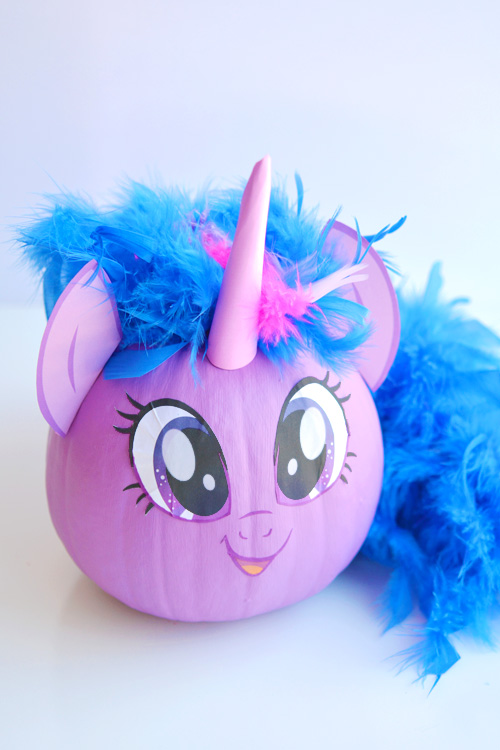 These no-carve My Little Pony pumpkins are SO EASY! Seriously, you paint the pumpkin, peel off the cute little printable faces and add a dollar store feather boa as the hair. So simple! (And best use of a feather boa, ever!)