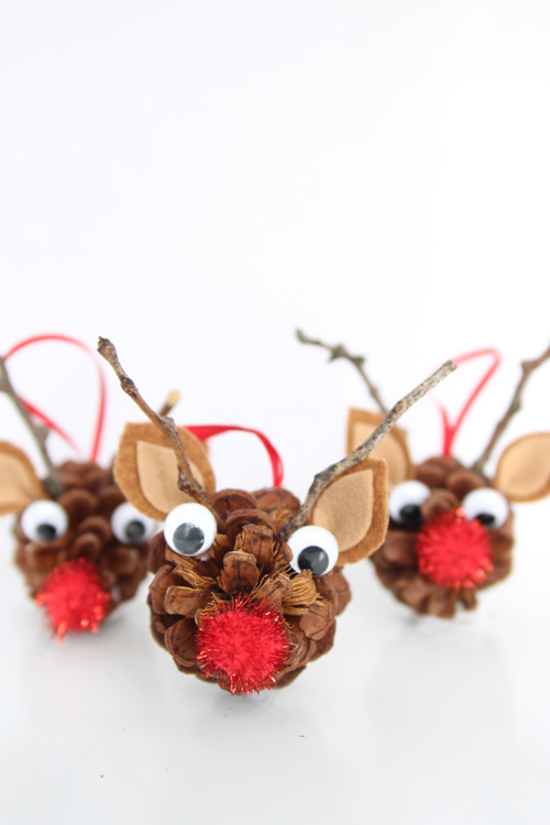 40+ Easy Christmas Crafts for Kids - Pinecone Reindeer Ornaments