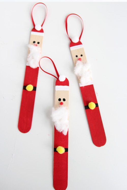 Create a DIY santa ornament out of popsicle sticks. These are SO CUTE and super easy to make!
