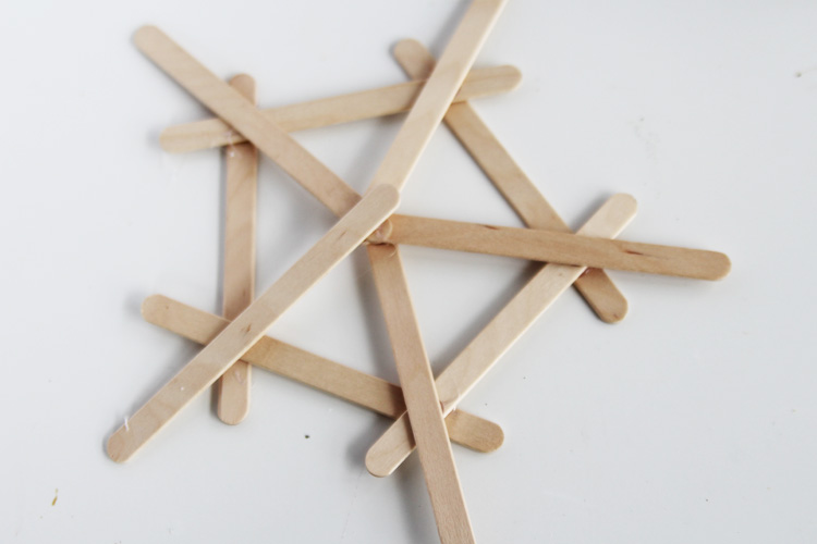 These DIY popsicle stick snowflakes are SO easy to make and look so bright and cheerful!