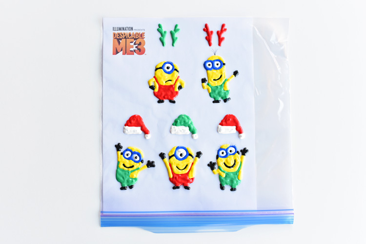 These Holiday Minion Window Clings were inspired by #DespicableMe3 now available on Blu-ray and DVD! They are so easy to make and they look so cute! What a fun way to add some holiday cheer to your windows!! #DM3Family #sponsored