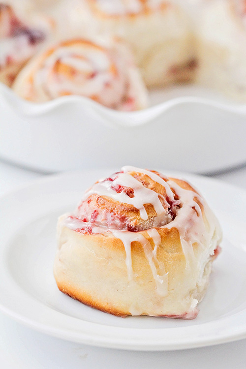 These raspberry cream cheese sweet rolls are ready in about 90 minutes, and so delicious! They're perfect for a tasty and sweet breakfast or dessert!